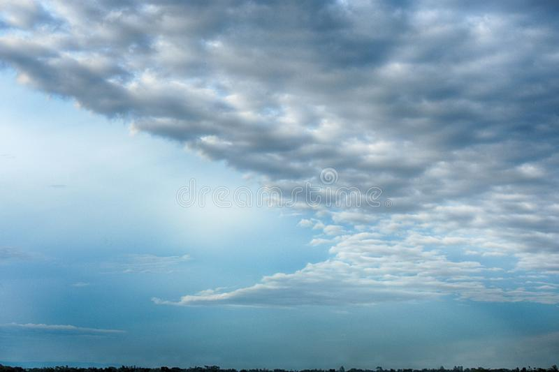 There is a dark cloud in the sky. royalty free stock photos