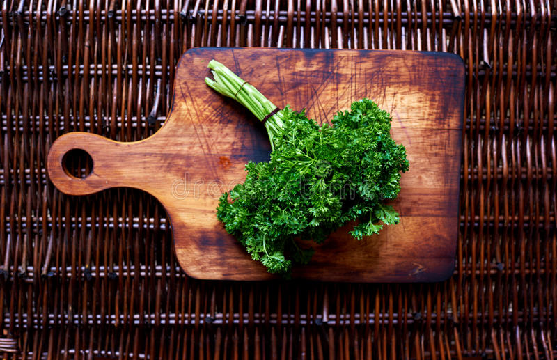 There are fresh herbs on rattan table stock image