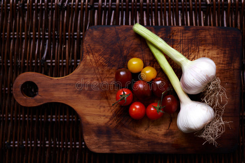 There are fresh vegetables on the table rattan stock photo