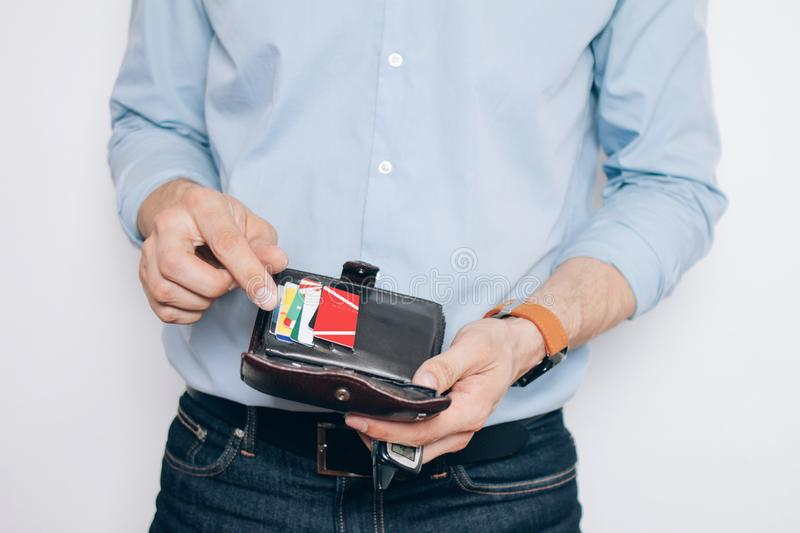 Hands with brown wallet with credit cards. There are the hands with brown wallet with a lot of credit cards stock image