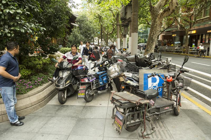 Motorbikes on the sidewalk in Shanghai stock image