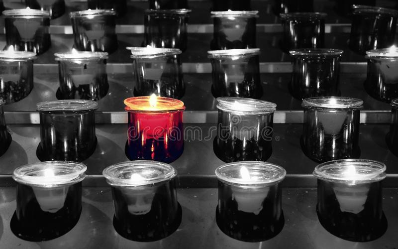 There is a Light That Never Goes Out. Group of votive candles with selective color royalty free stock photos