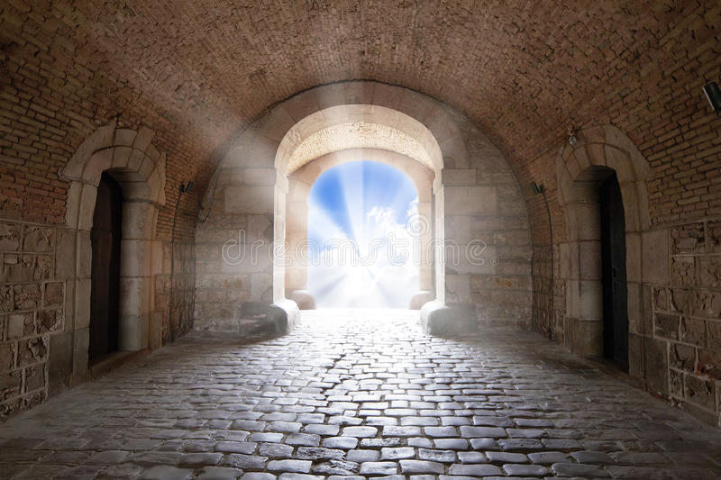 There is the light sky in the end of arch in a tunnel. As background royalty free stock photos