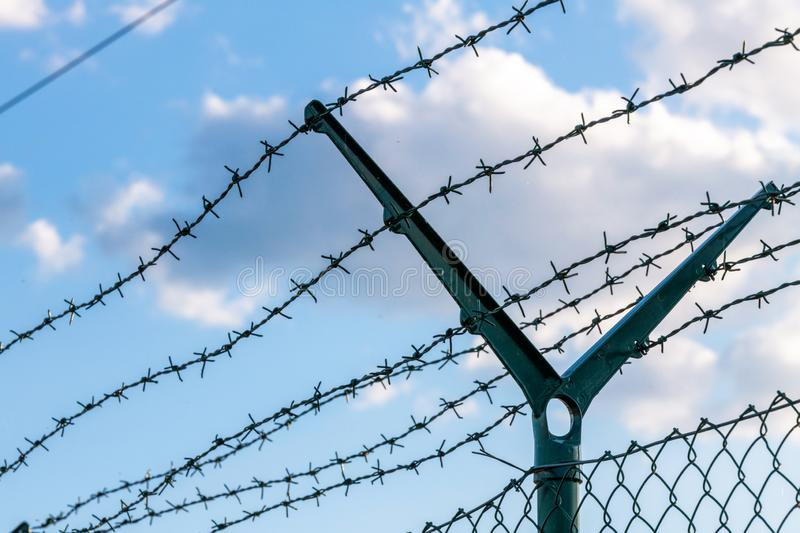 Fence with double barbed wire. There are many things that need to be secured and barbed wire does good service stock image