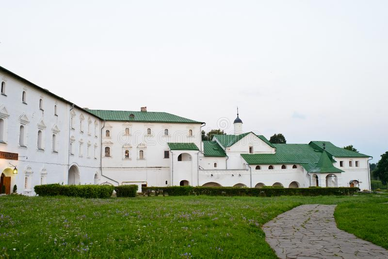 A monastery with green roof. There is a monastery with green roof and white wall in Russia. The garden is very big. It is peachful stock photo