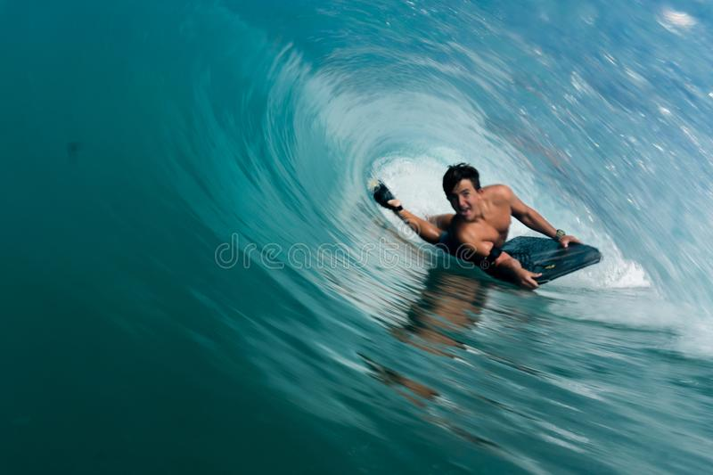 In There. This is my friend pulling into a shorebreak barrel in hawaii stock photography