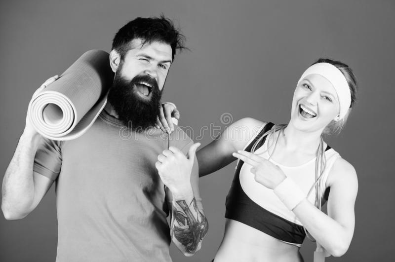 There is no I in Team. Go big or go home. Sporty couple training with fitness mat and skipping rope. Strong body muscles. Sport equipment. Athletic Success royalty free stock images
