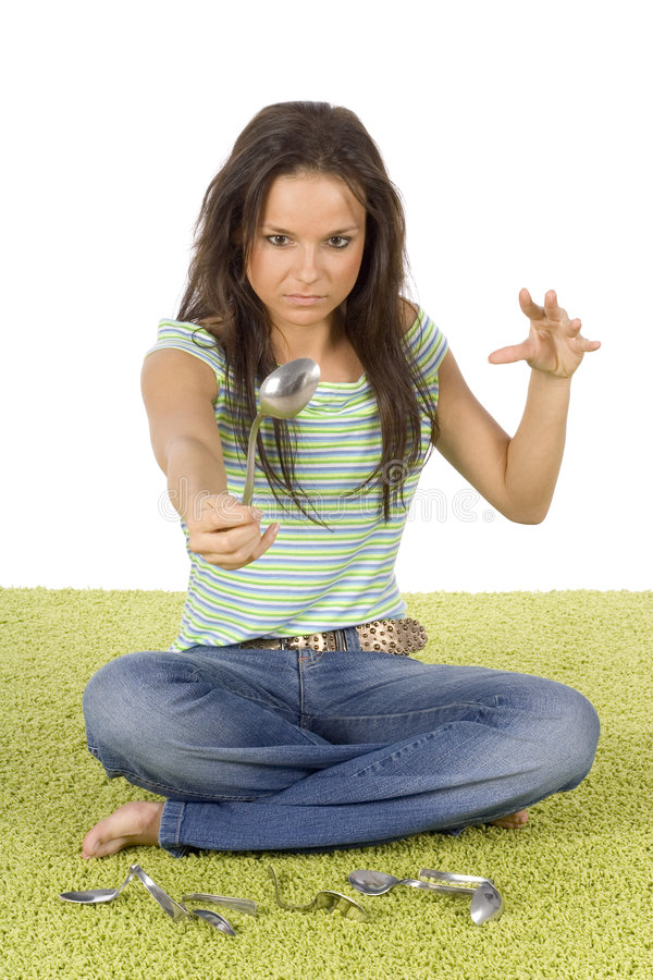 There is no spoon (woman on carpet) royalty free stock photo