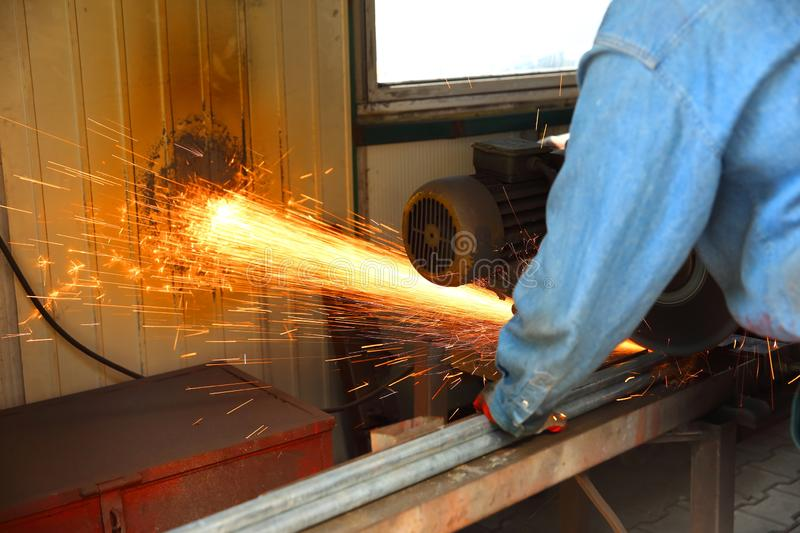 Cutting steel with a stationary grinder. royalty free stock images