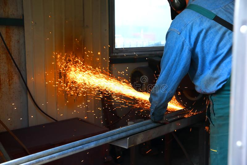 Cutting steel with a stationary grinder. royalty free stock photos