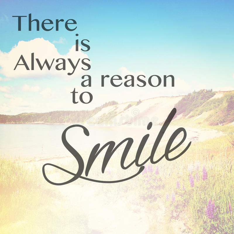 There is always reason to smile. A text overlay There is Always a reason to Smile on nature background stock photography