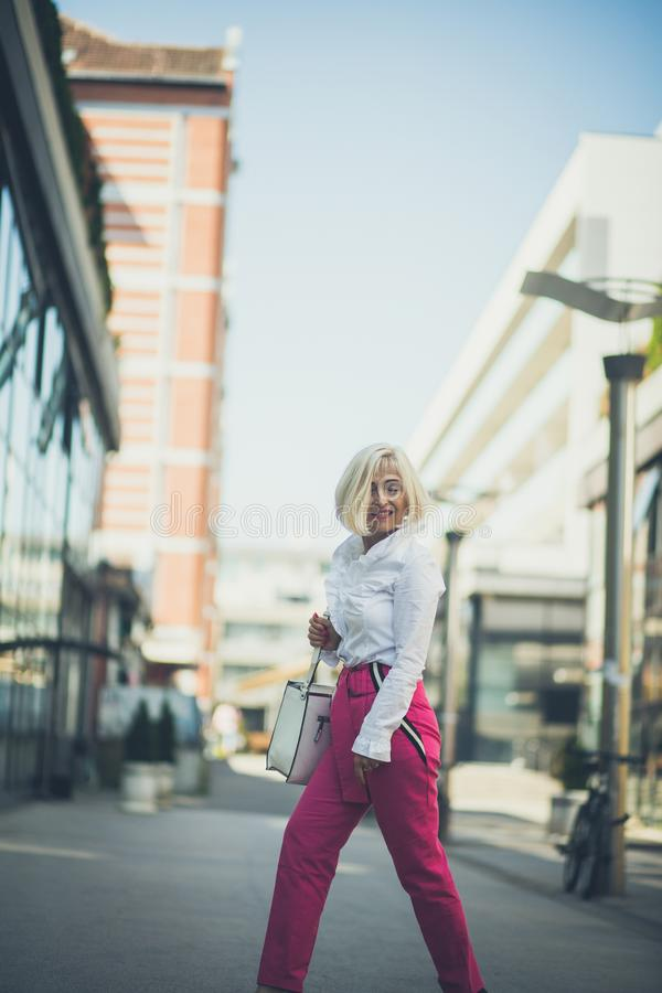 There`s so many things to explore. Senior business woman stock images