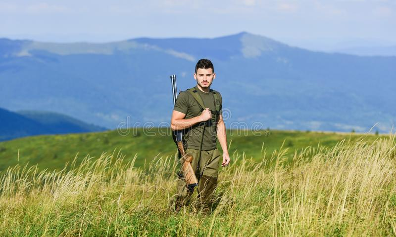 There is safety in numbers. hunter hobby. military style. male in camouflage. muscular man hold weapon. purpose and royalty free stock photos