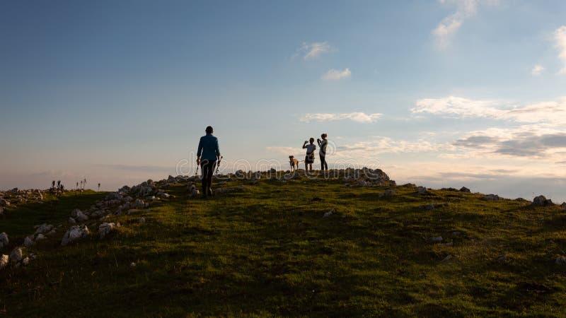Friends hiking through the wilderness of Buila Vanturarita National Park in Romania stock photo
