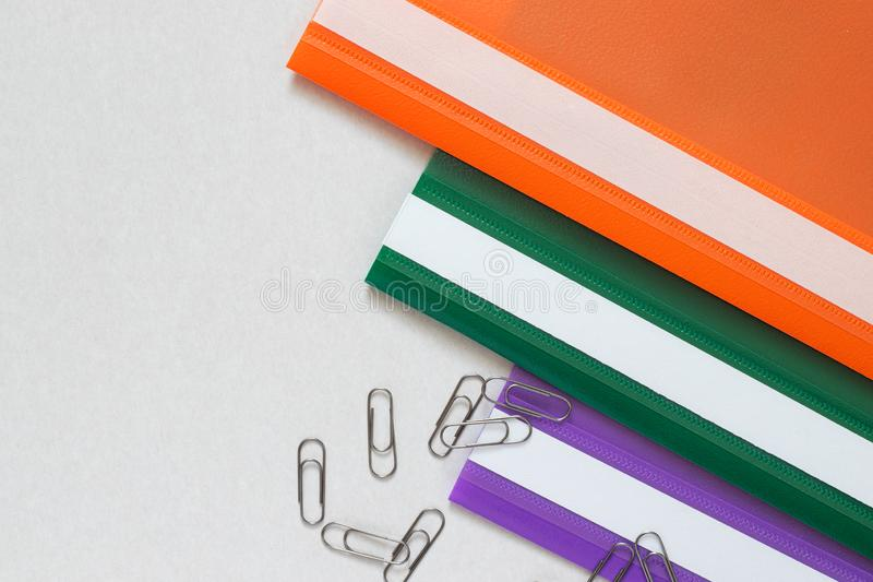 Plastic folders in three colors with clips royalty free stock photos