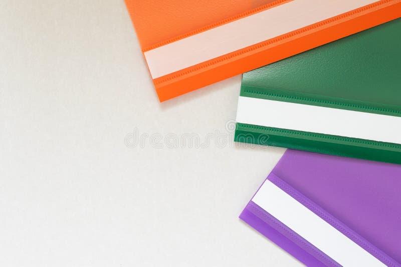 Plastic folders in three colors stock image