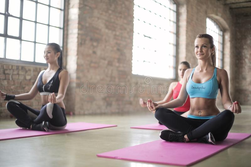 There Women in a Yoga Session royalty free stock photography