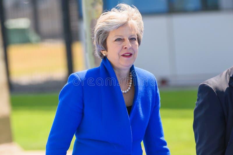 Theresa May, durante la SOMMITÀ di NATO 2018 fotografia stock libera da diritti