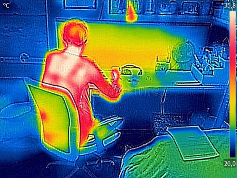 Thermal image Young Girl using laptop stock photography