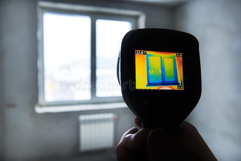 Thermal imaging camera inspection of building. check temperature royalty free stock photography