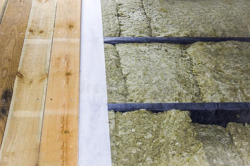 Thermal insulation of the floor in the frame house, vapor barrier, lags. Close up stock images