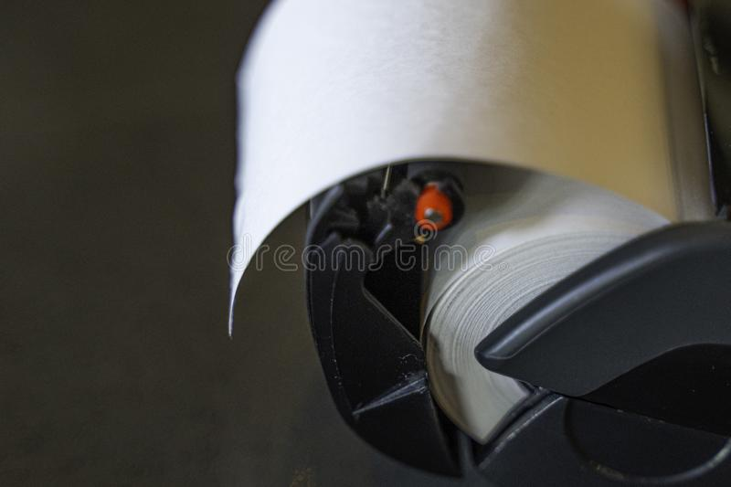 Thermal Paper roll in a Credit Card Point of Sale - POS - Machine. In a shop stock images