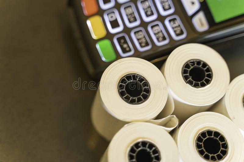 Thermal Paper Rolls with a point of sale machine royalty free stock images