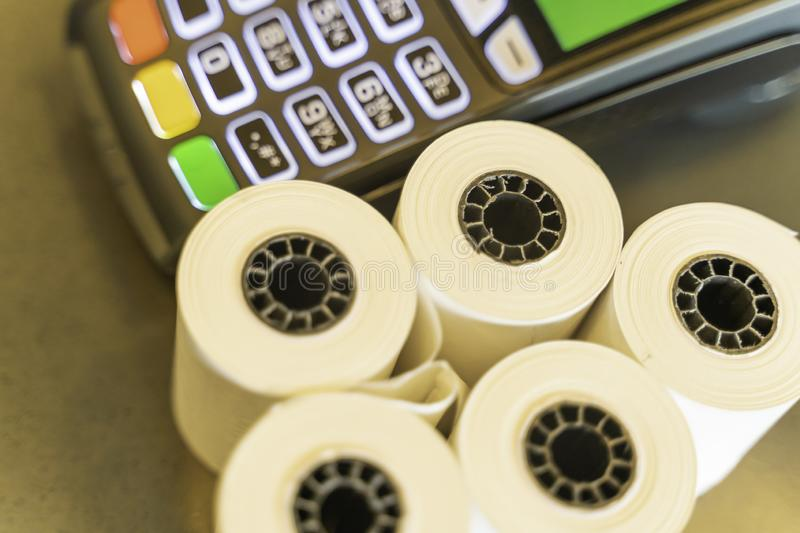 Thermal Paper Rolls with a point of sale machine stock images
