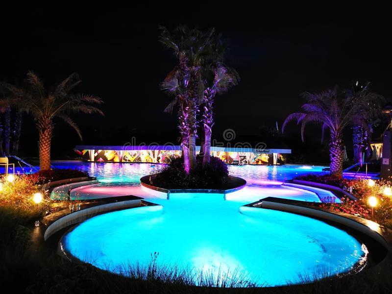 Thermal pool outdoor in the night at Balotesti, Romania. Therme Bucharest. Pool bar and thermal pool outdoor in the night at Therme Bucharest, Romania royalty free stock images