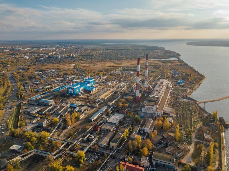 Thermal power plant. Aerial view from drone of large industrial area on shore of Voronezh water reservoir stock photo