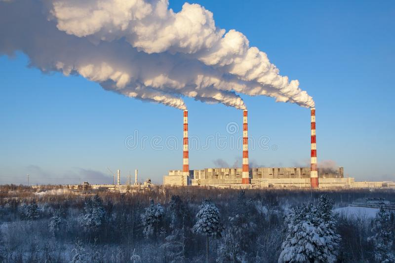 Thermal power plant in Siberia. Surgut. Thermal power plant. Bright chimneys against a very blue beautiful sky. Concept: ecology, cleanliness, industry stock photo