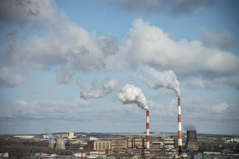 Thermal power plant. Environmental pollution, emission of production wastes by thermal power plant royalty free stock photos
