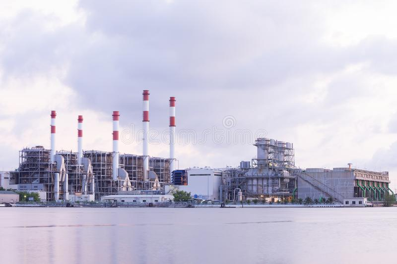Thermal power plant at sunrise. Thermal power plant factory at sunrise royalty free stock image