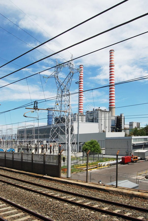 Thermal power station - Coal. A thermal power station is a power plant in which the prime mover is steam driven. Water is heated, turns into steam and spins a royalty free stock photography