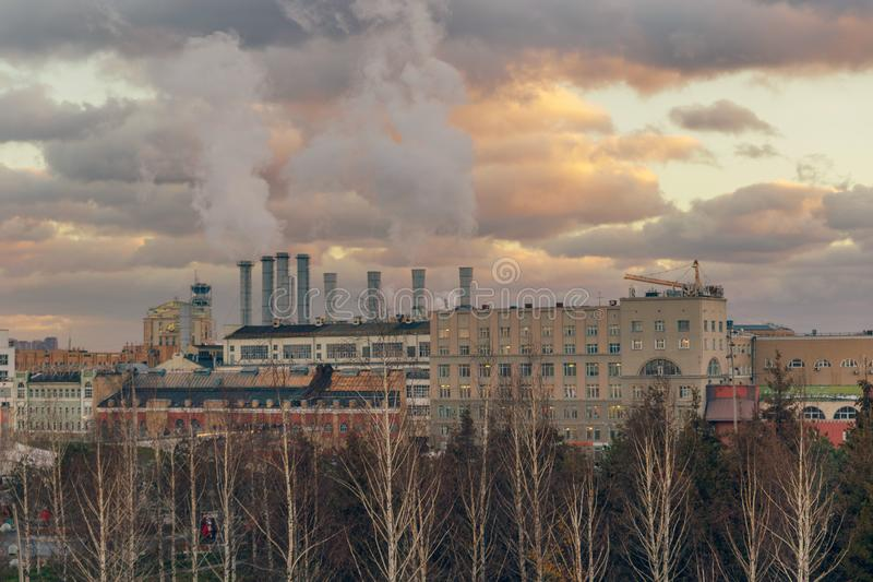 Thermal power station with steaming pipes evening view in Moscow stock photos