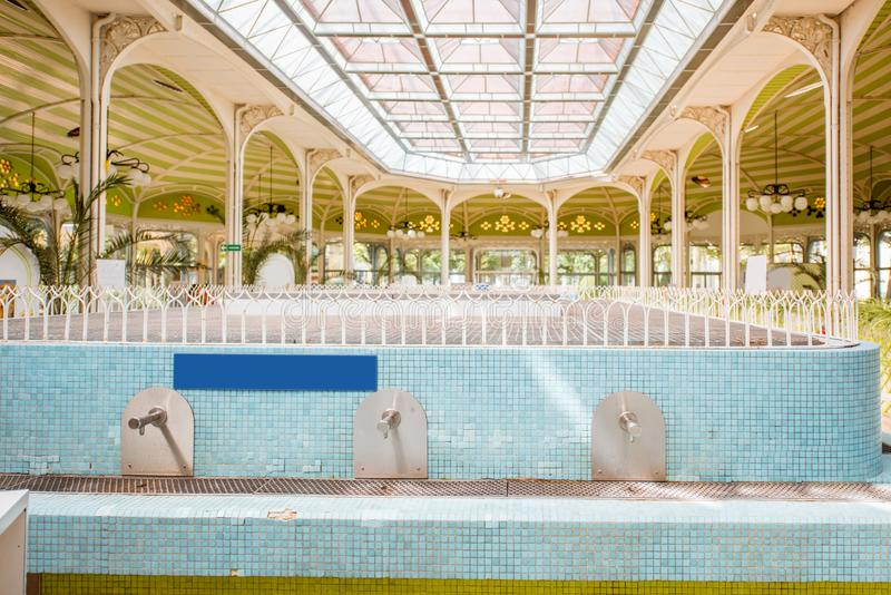 Thermal pump-room in Vichy. Beautiful interior view of the old thermal pump-room with healing water in Vichy city in France stock image