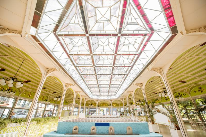 Thermal pump-room in Vichy. Beautiful interior view of the old thermal pump-room with healing water in Vichy city in France royalty free stock photos