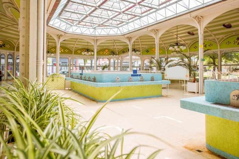 Thermal pump-room in Vichy. Beautiful interior view of the old thermal pump-room with healing water in Vichy city in France stock images