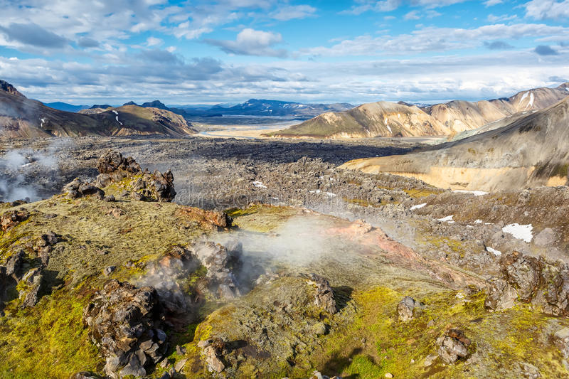 Thermal springs and lava fields in Landmannalaugar valley in Ice. View of thermal springs and lava fields in Landmannalaugar valley in Iceland stock image