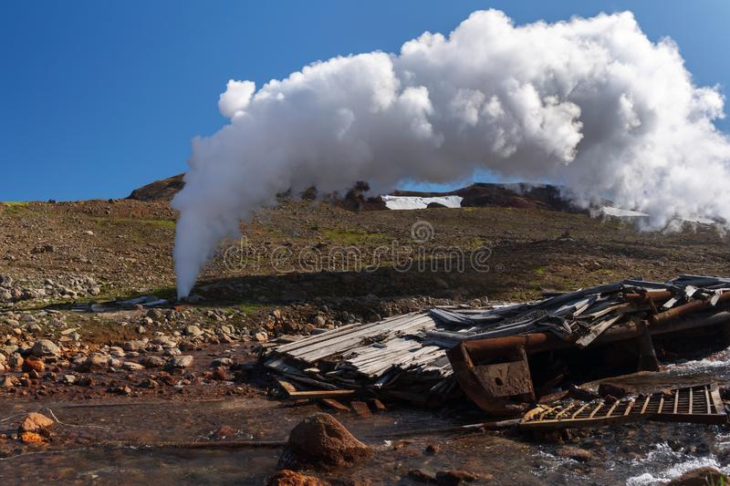 Thermal steam-water mixture Emission from well in geothermal deposit area. Emission of mineral natural thermal water, steam steam-water mixture from geological royalty free stock photography