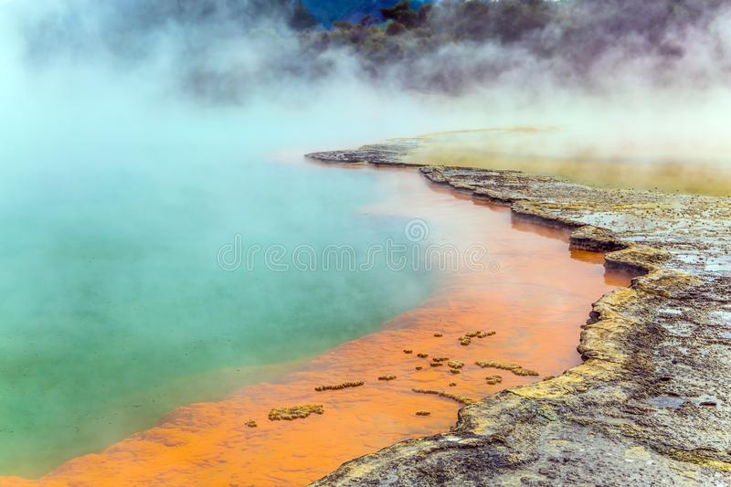 Thermal Wonderland. Of hot waters is Wai - O - Tapu. New Zealand, North Island. Picturesque lake of multicolored thermal waters evaporates in the air. The royalty free stock image