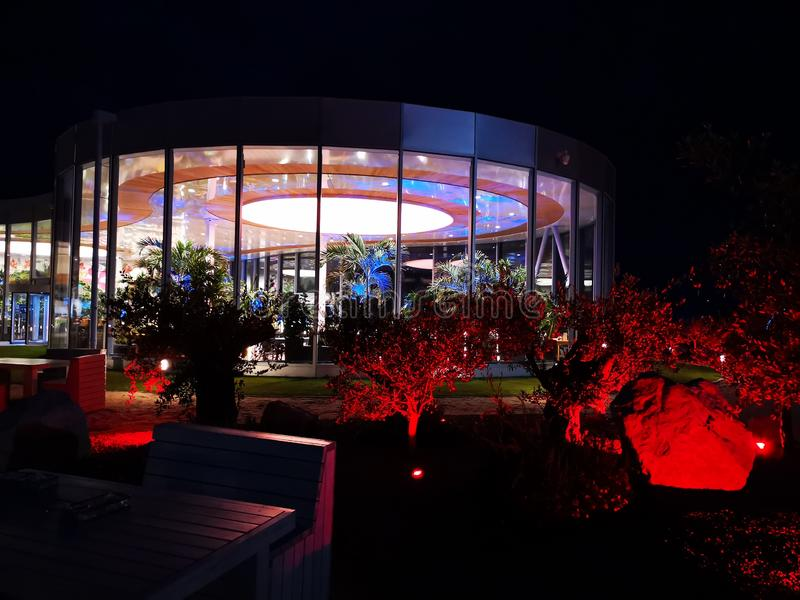 Therme Bucharest outdoor in the night. Therme Bucharest, Romania outdoor in the night - terrace area colorful lights outdoor stock photography