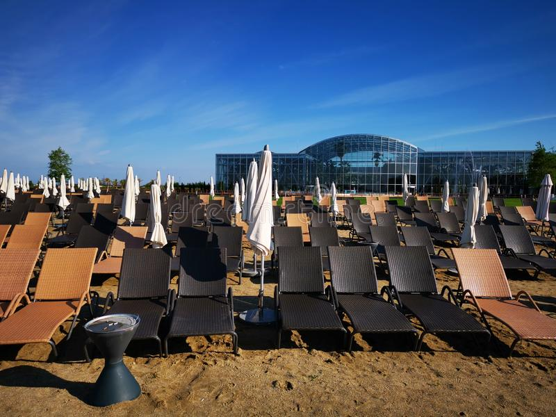 Therme Bucharest outdoor pools with thermal water and sunbeds stock photo
