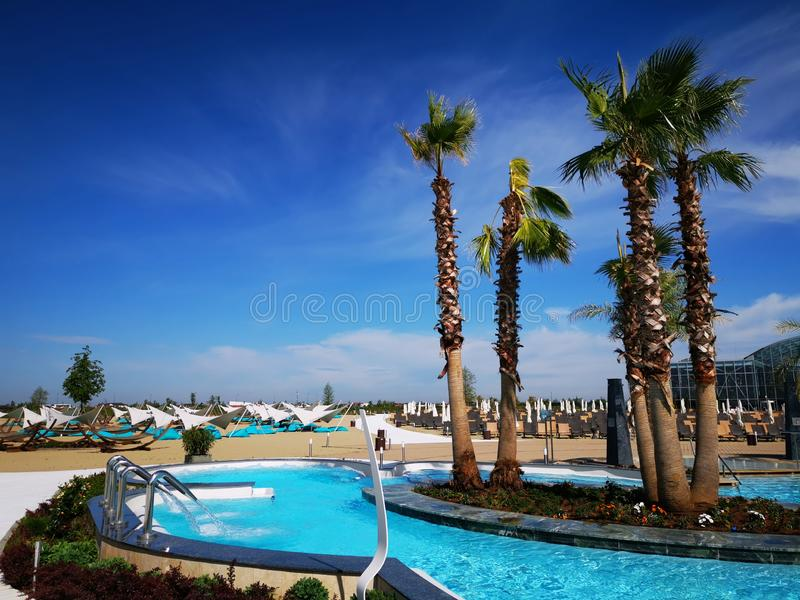 Therme Bucharest outdoor pools with thermal water. And hydromassage at Balotesti, Romania royalty free stock photo