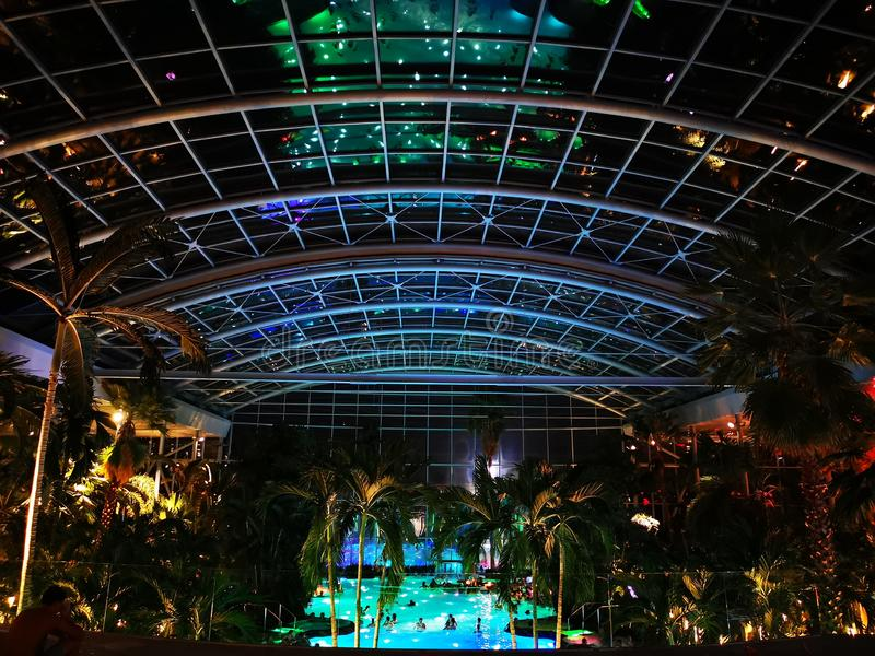 Therme Bucharest, Palm Zone in the night. Indoor pool with thermal water stock photo