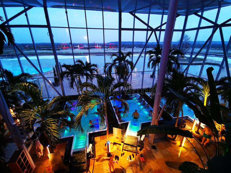 Therme Bucharest, Palm Zone in the night. Indoor pool with thermal water and colorful lights underwater royalty free stock photos