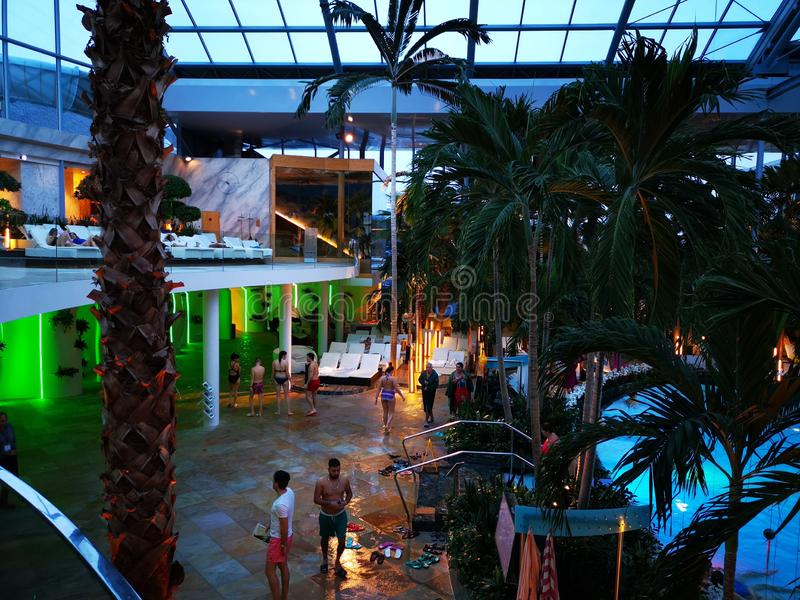 Therme Bucharest, Palm Zone in the night. Indoor pool with thermal water and colorful lights royalty free stock photos