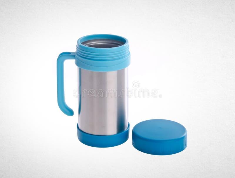 Thermo kopp eller thermo kopp för rostfritt stål på en bakgrund royaltyfria foton