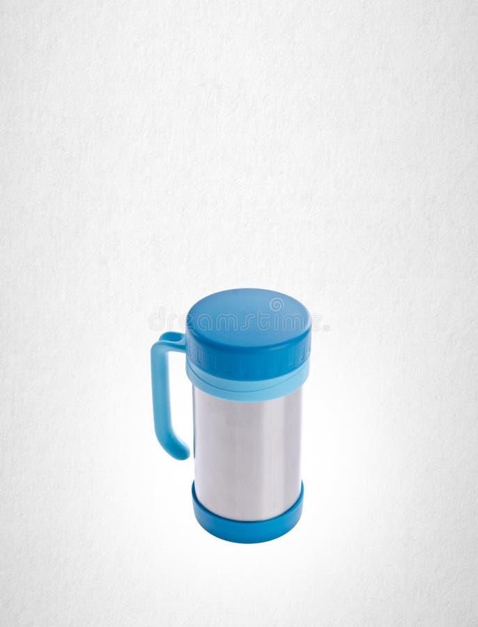Thermo kopp eller thermo kopp för rostfritt stål på en bakgrund royaltyfri foto
