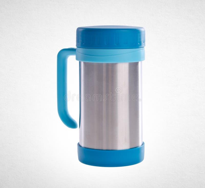 Thermo kopp eller thermo kopp för rostfritt stål på en bakgrund arkivfoton